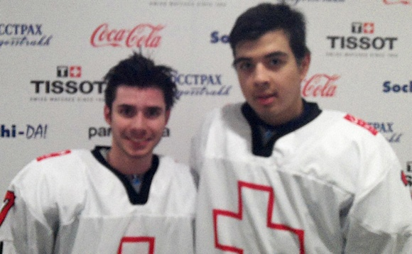 Photo: Swiss defensemen Xeno Busser (L) and Jonas Siegenthaler (R) pose together following their country's opening win over Slovakia at the 2013 U18 WJC (courtesy of Chapin Landvogt)